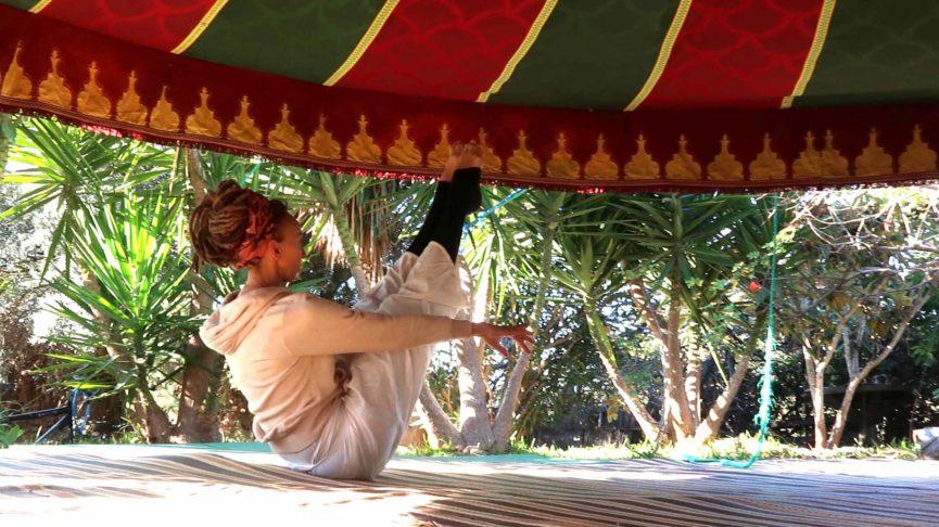Yogi in boot asana